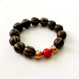 Clay bead bracelet with copper and red trade bead